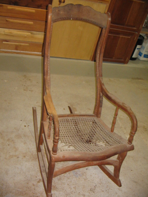 Early 1900 cherry cained rocking chair